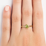 14K YELLOW GOLD SOLITAIRE BEZEL RING WITH TRILLION PERIDOT