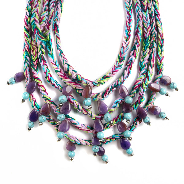 HO NECKLACE WITH TURQUOISE AND PURPLE HUE THREADS WITH PURPLE AND BLUE BEATS.