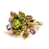 925 SILVER GOLD PLATED RING WITH EMERALD CUT PERIDOT AND CYRSTALS