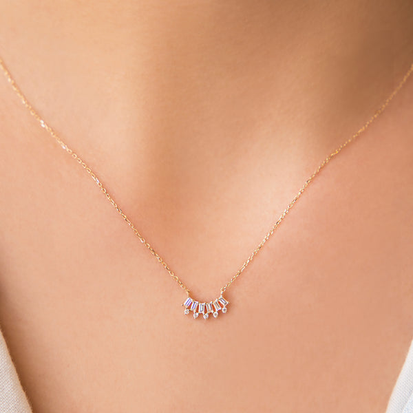14K GOLD PENDANT WITH ROUND AND BAGUETTE DIAMOND