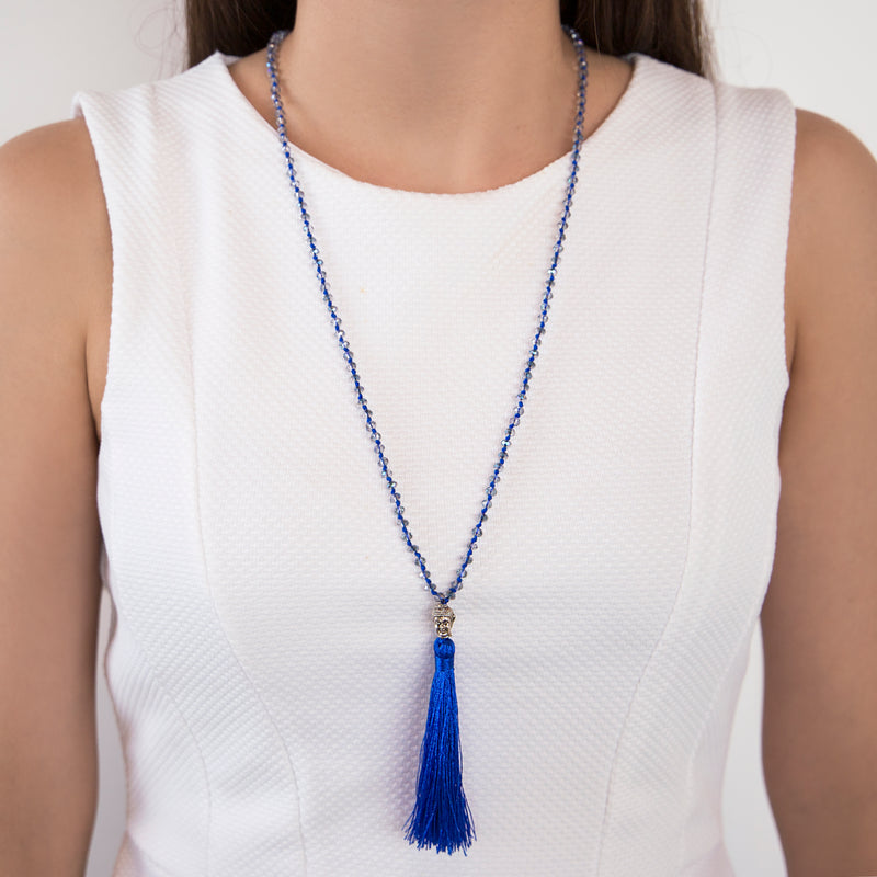 THREAD NECKLACE WITH BLUE TASSELS AND CRYSTALS