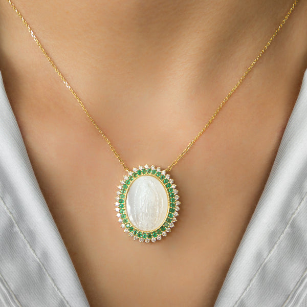 14K GOLD MEDAL NECKLACE WITH VIRGIN OF MOTHER OF PEARL, DIAMONDS AND EMERALD