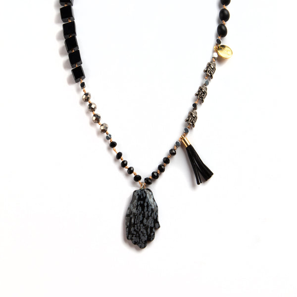 HO NECKLACE WITH BLACK BEATS AND HAND PENDANT.