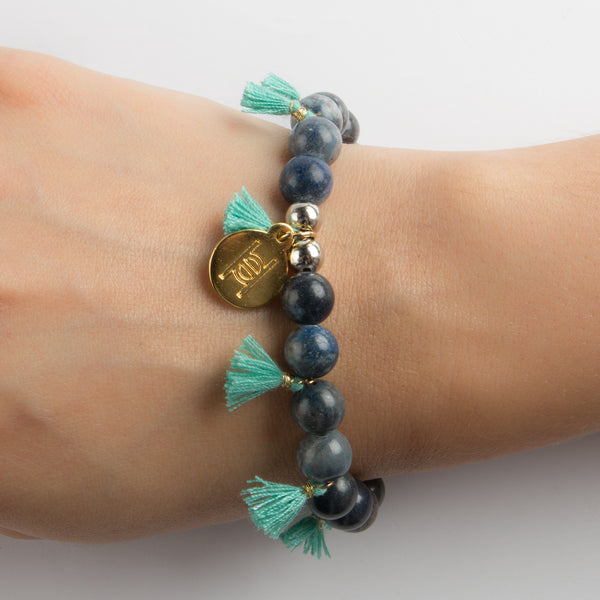 BRACELET WITH STONES AND TASSELS