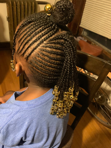 Small braids with beads were added...