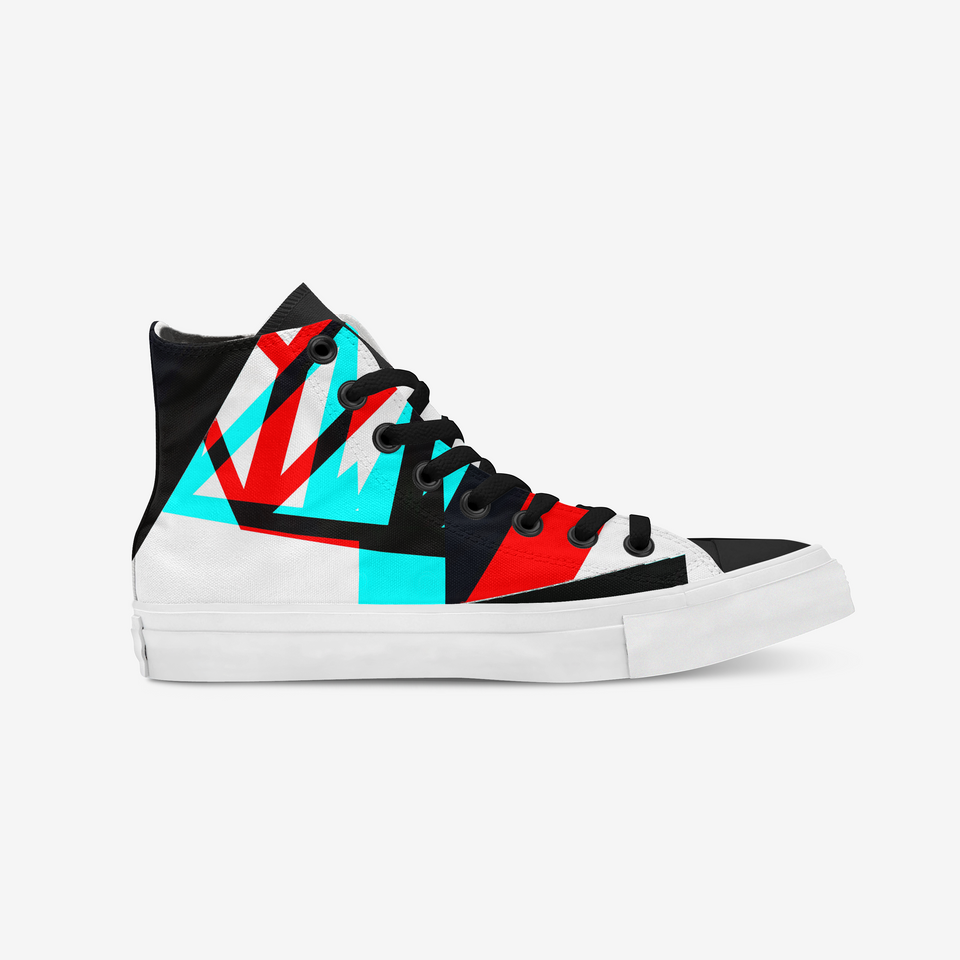 White sneaker view from the side that shows a geometric design made of asymmetric lines, triangles and rectangles. The colors of the figures are neon green and red combined with black. The holes where the black shoelaces are placed are covered with a black metal ring. The shoe sole is all in white.