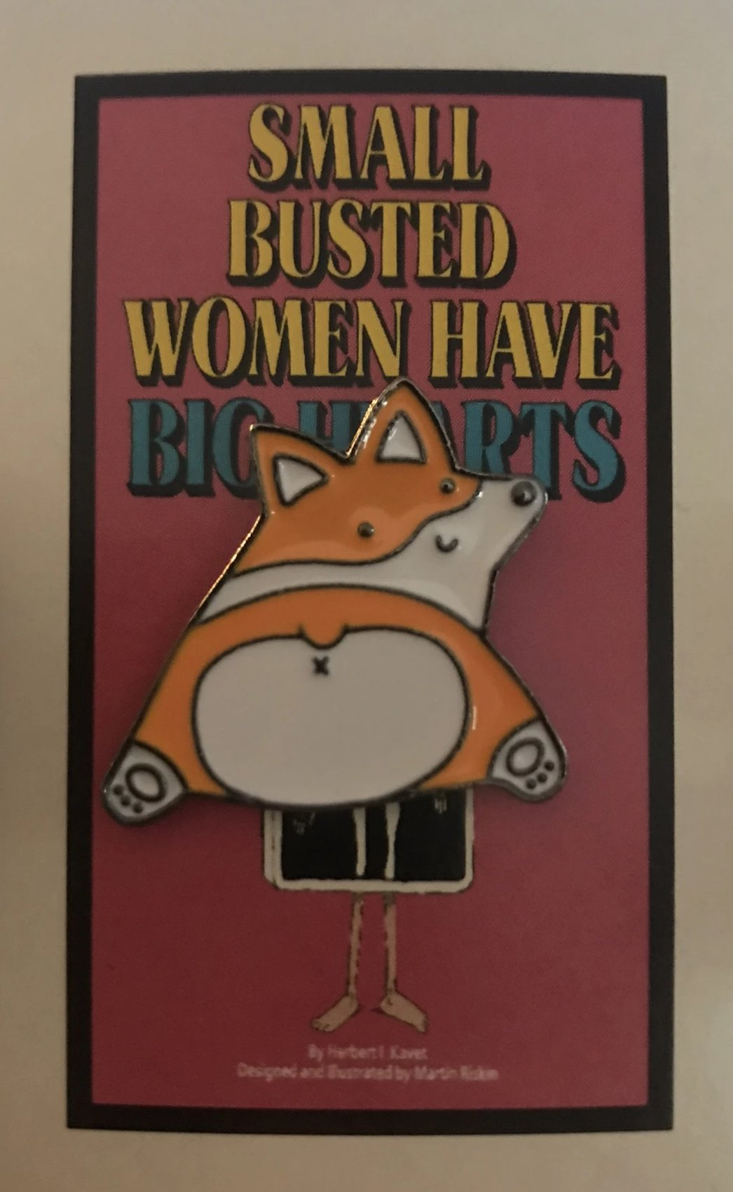 Enamel pin on a vintage card