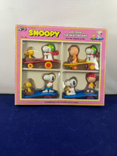Load image into Gallery viewer, Snoopy and Friends Skateboard Figurines