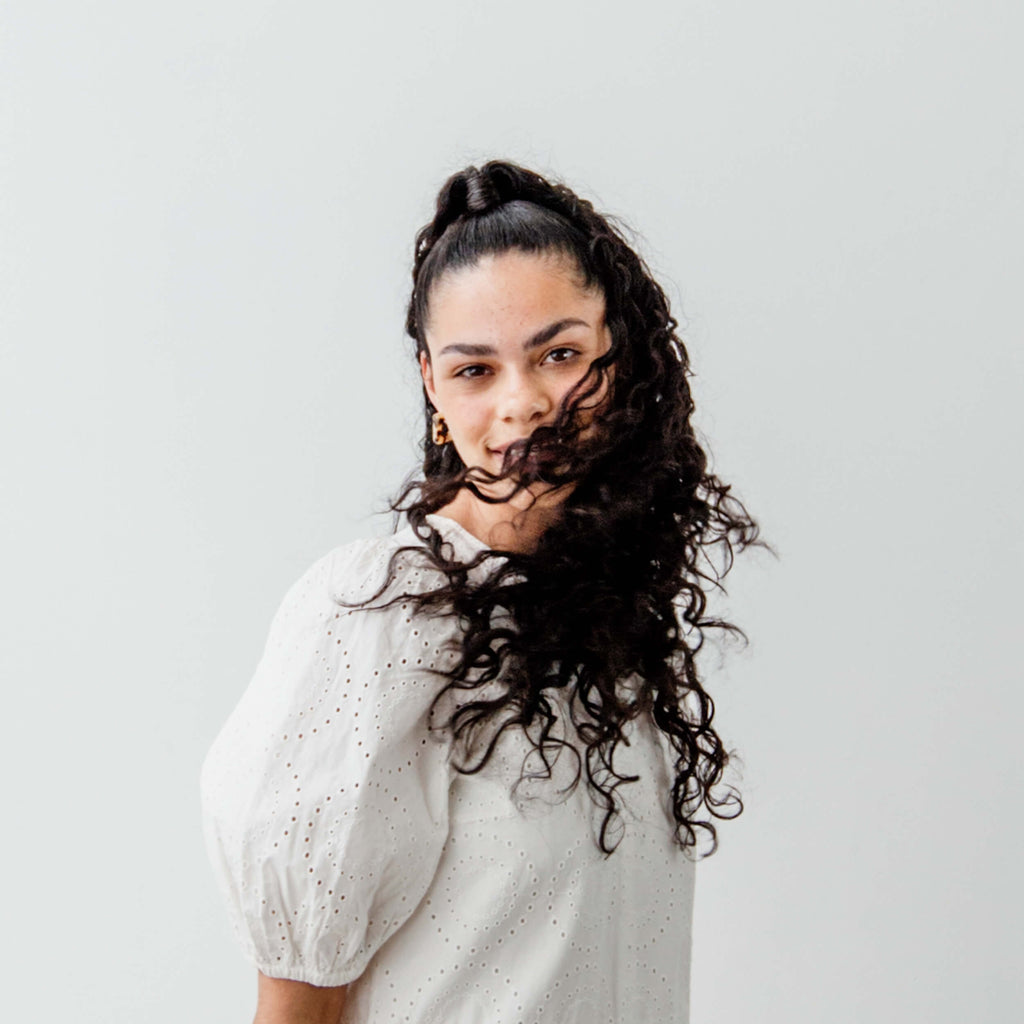 A woman swishes her hair