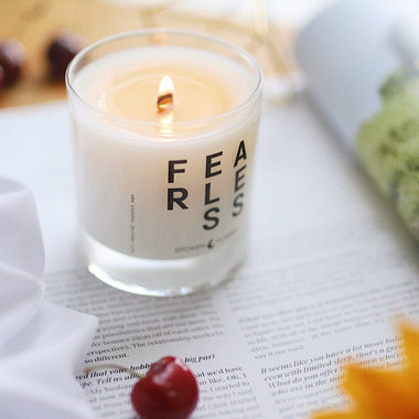 Spoken Flames' Fearless Candle on a magazine