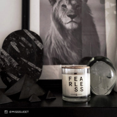 Spoken Flames' Fearless Candle next to a picture of a lion