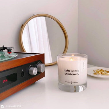 Spoken Flames' Light It Into Existence Candle on a dresser near record player