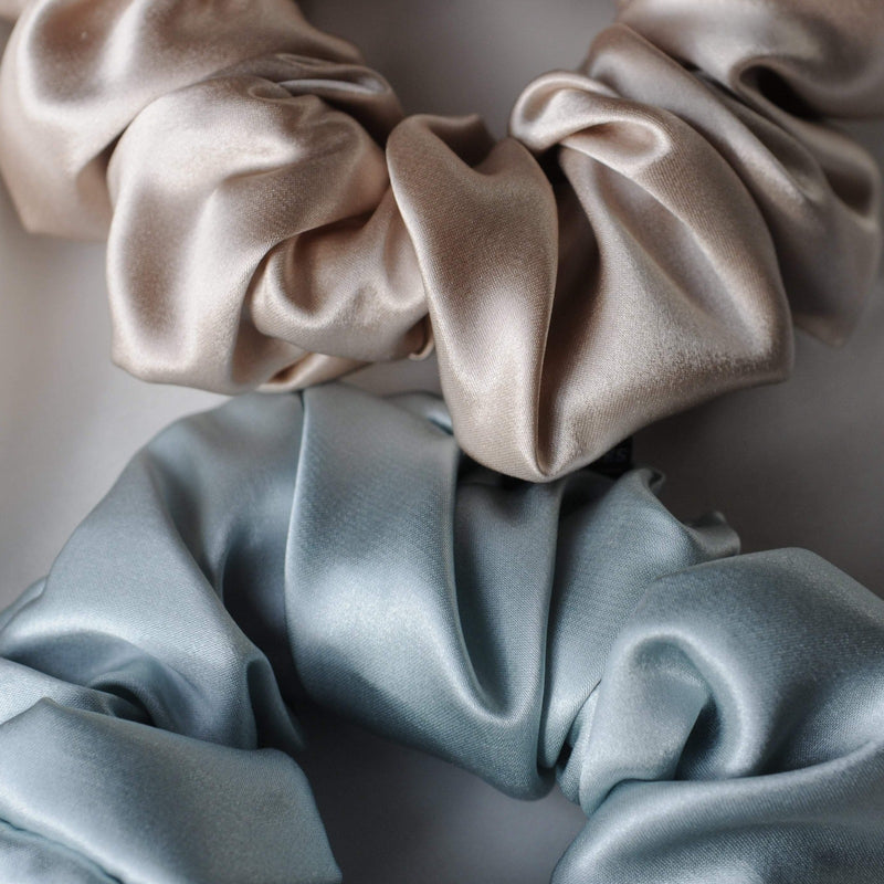 Caramel and sky blue Silk Works London large silk scrunchies.
