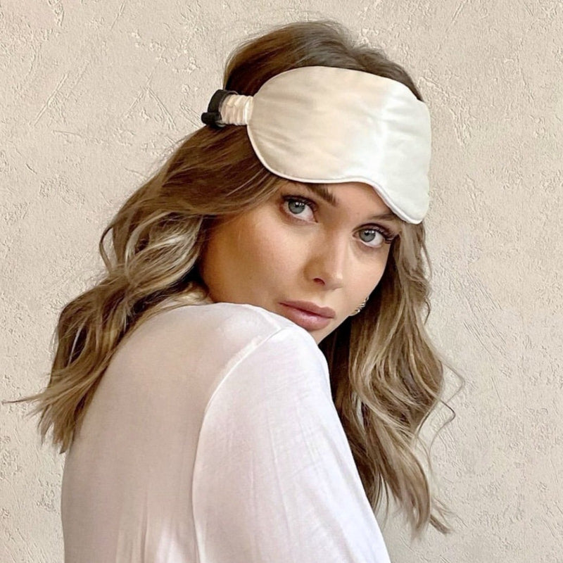 lady wearing ivory silk eye mask on head