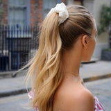 lady wearing large ivory 100% mulberry silk scrunchie in hair