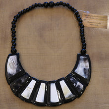 Load image into Gallery viewer, Horn Jewelry Bridge Necklace - on wood background