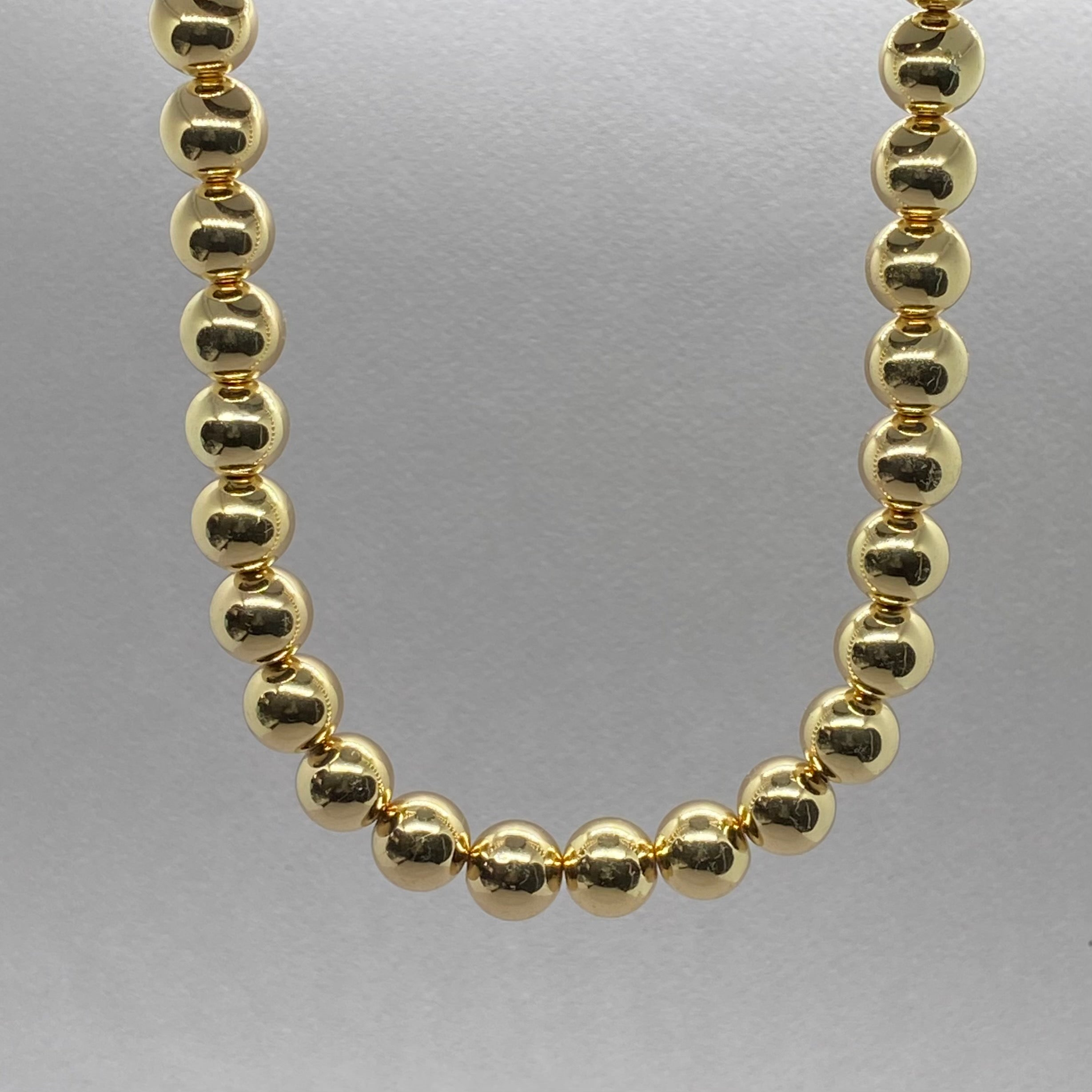 GOLD BEAD STATEMENT NECKLACE