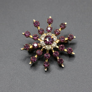Vintage c 1950s purple and clear stone starburst brooch