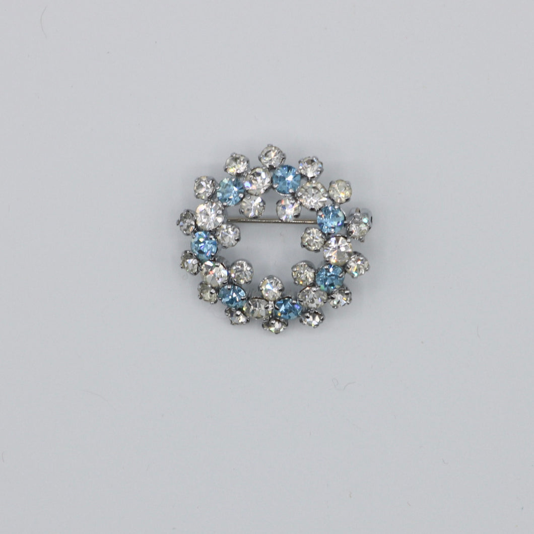 Vintage 1950s blue and clear rhinestone wreath brooch