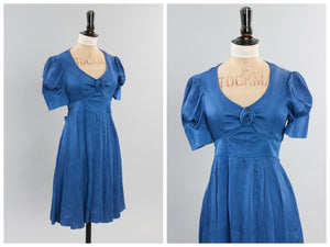 Vintage original 1970s does 1940s Jeff Banks blue finely pleated dress with rosette detail UK 8 10 US 4 6 XS S