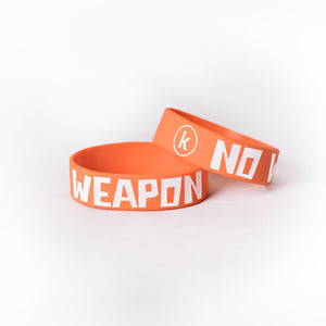 No Weapon Kids Wristband (Orange) 'K' logo