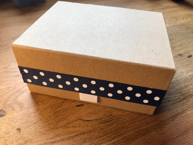 Luxury kraft gift box with a spot ribbon. Lid clips shut with a magnet