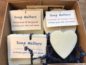Three soaps and a small heart soap