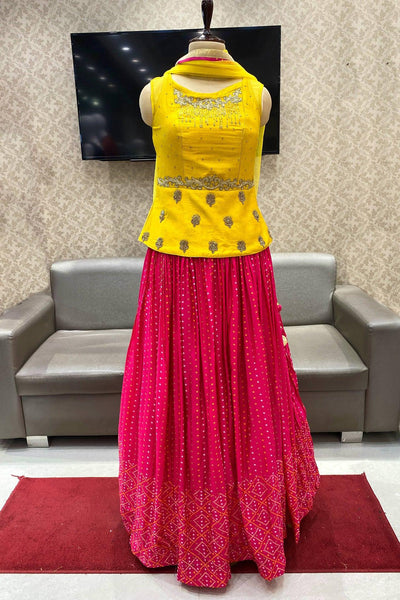 Yellow and Rani Pink Bandhani Print Peplum Style Crop Top Lehenga - VIew 1