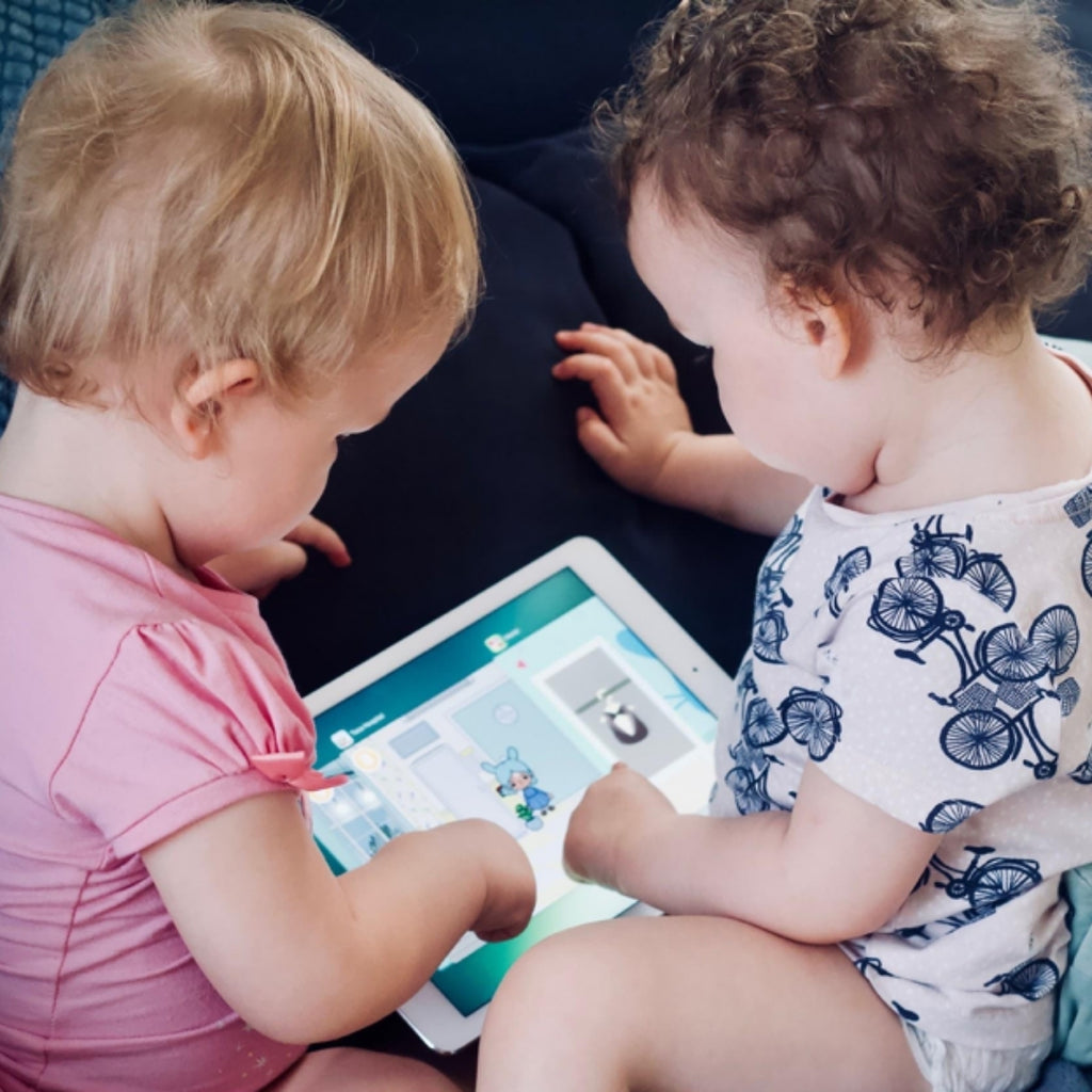 babies using tablet