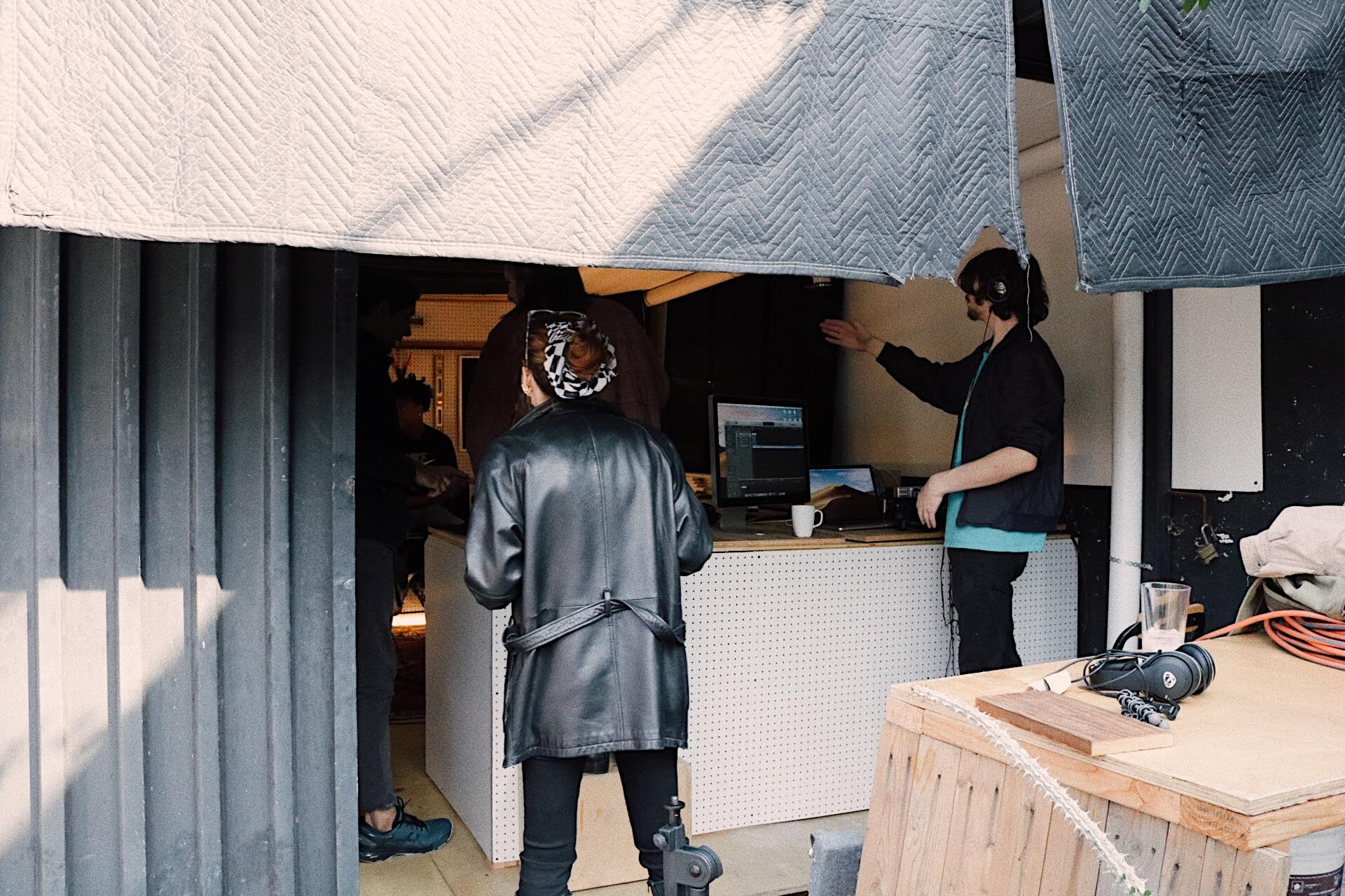 People working outside the Tiny Shed to prepare for recording.