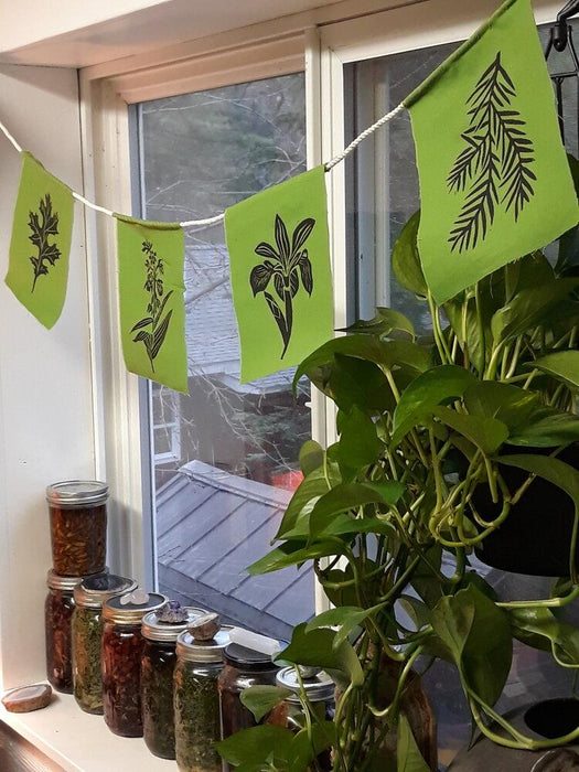 Wild Botanical Prayer Flags hanging over window