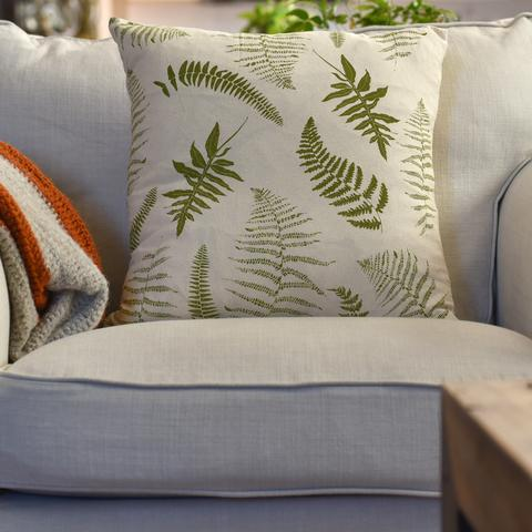 Pillow with ferns printed on it