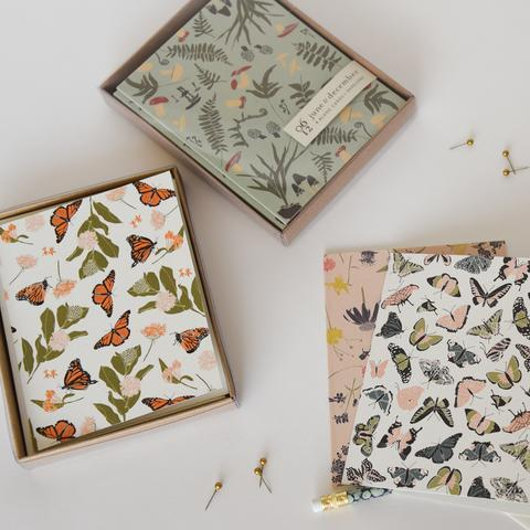 assorted boxed notecards, including forest finds