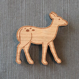 a deer wood brooch pin, lasercut fall fashion ideas for blazers and coats with a  woodland theme