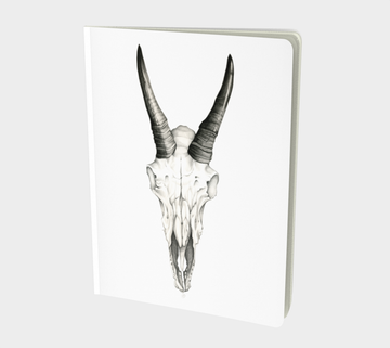 Sketch book or notebook with pencil drawing of a skull by Canadian artist Leah Pipe. Beneath My Bones