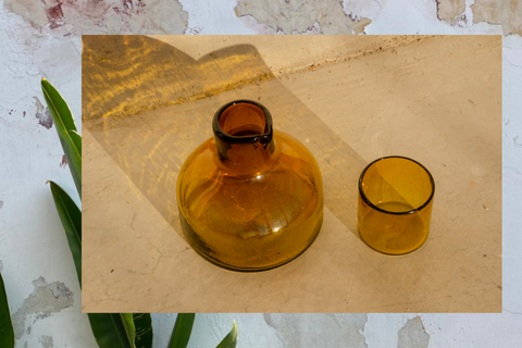 Whether it is displayed as the main piece or full of your choice of flowers, this Xibalba glass object will become your favorite statement. Each piece is individually mouth-blown in repurposed glass by an artisan cooperative in the Guatemalan highlands.