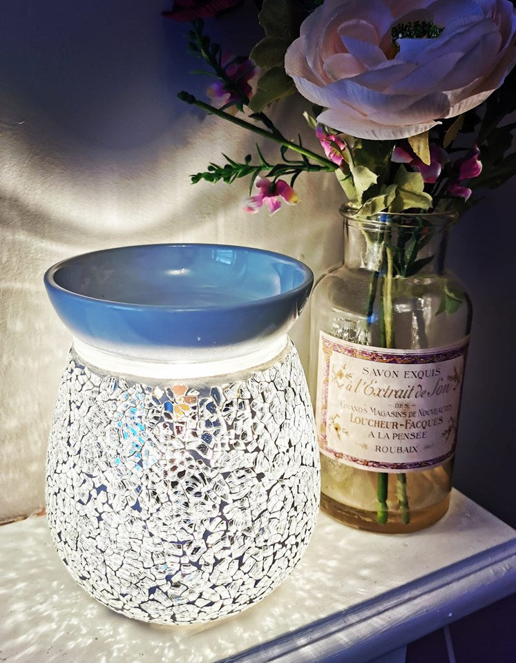 sparkling silver crackle glass mosaic electric wax warmer / aroma lamp. shown lit / switched on.