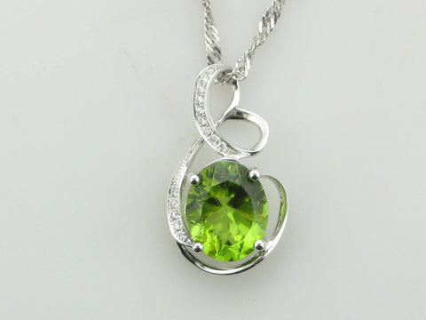 Oval Peridot and Diamond Swirl Pendant