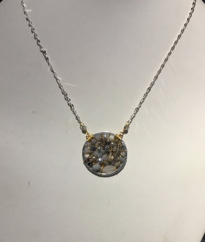 Gold and silver circle pendant necklace