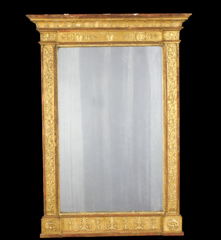 A French late 19th century Empire revival giltwood and composition mirror