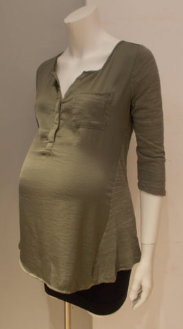 A Pea In The Pod Maternity green crochet back blouse
