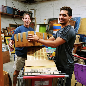 Two men packing boxes