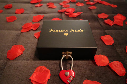 treasure box with a heart shaped lock surrounded by rose petals