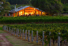 Winery and vineyard at dusk at Cullen Wines