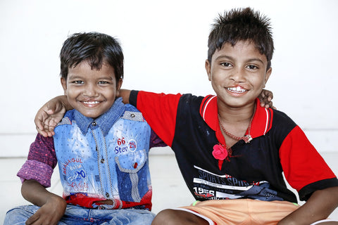 Seven-year-old Monu and Bipul pose for a photo during patient announcement day. Photo: Jasmin Shah.