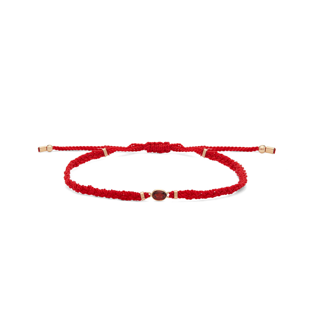 Red woven bracelet beautifully braided with a garnet gemstone and finished with subtle 14k gold accents. These best-selling bracelets are handwoven by women at The Rode and create job opportunities for women overcoming homelessness.