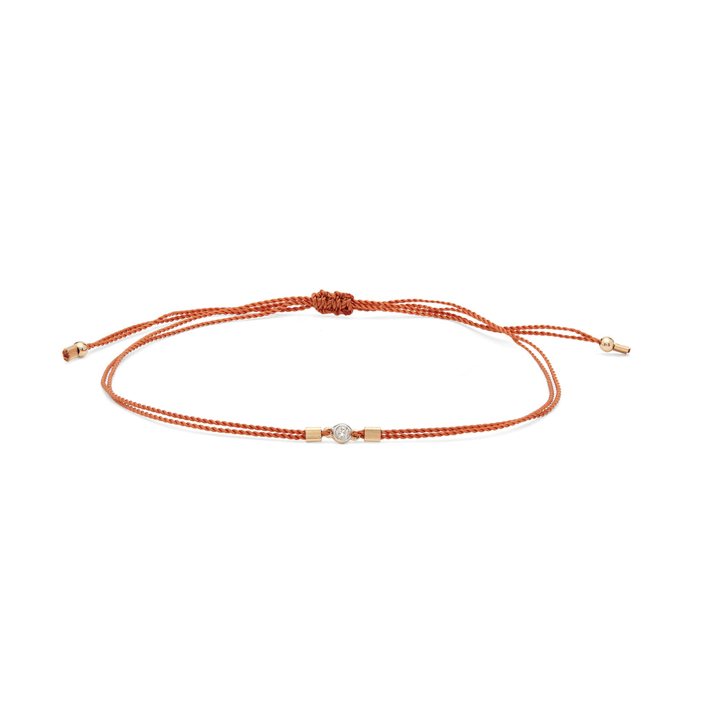 Dainty terracotta woven bracelet with a mini diamond and 14k gold accents. The Rode's bracelets are handmade by women in Los Angeles overcoming homelessness.