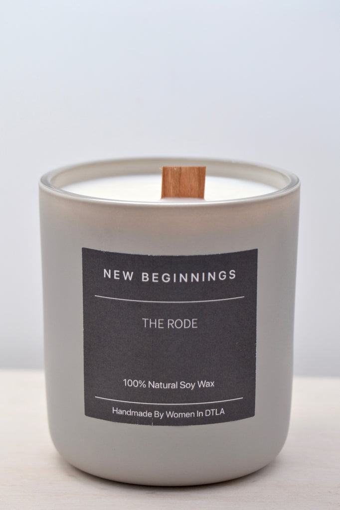 Premium natural 100% soy wax New Beginnings candle handmade by women overcoming homelessness in Los Angeles. Hints of musk and calming top notes of geranium. Double wooden wicks in a reusable stone matte jar.