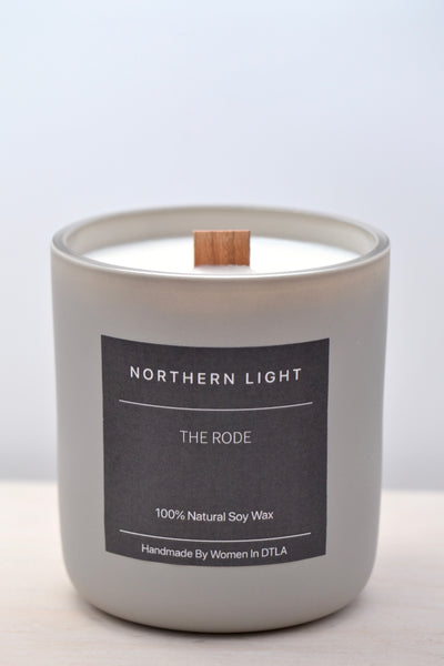 Premium natural 100% soy wax Northern Light candle handmade by women overcoming homelessness in Los Angeles. Sweet and salty oceanic aroma with calming heart notes of cardamom. Double wooden wicks in a reusable stone matte jar.