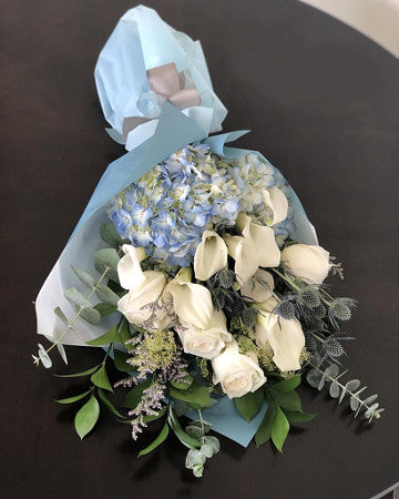 C7902 - Wrapped Flowers Bouquet